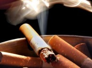 How does tobacco smoking affect headaches?